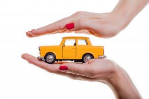 IATF16949 Quality audits, car safety, toy car safely held in hands